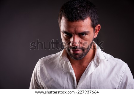 man with evil look - stock photo