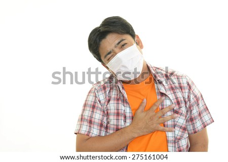 Man with face mask having cold - stock photo