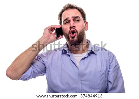 Man with facial expression talking on cellphone against his ear