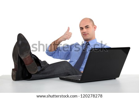 Man with feet on the table - stock photo