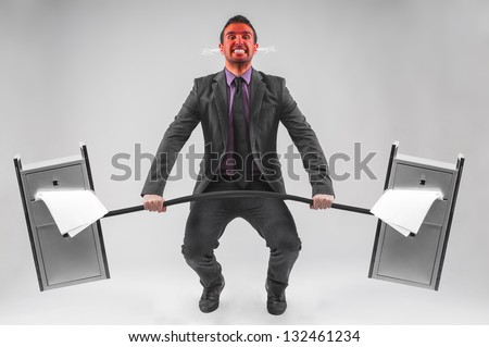 man with file cabinet as dumbbell - stock photo