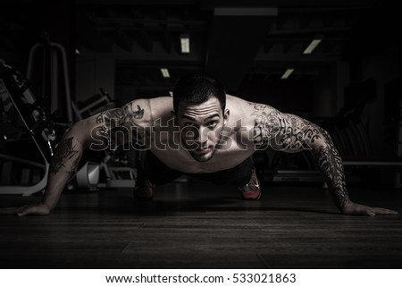 Man with focused eyes doing pushups