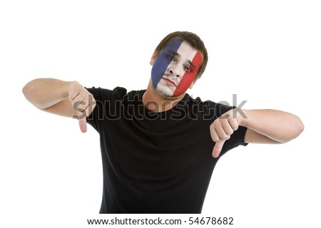 man with french flag painted on his face showing two thumbs down, isolated on white background - stock photo