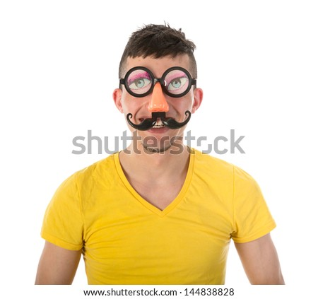 Man with funny carnival mask isolated over white - stock photo