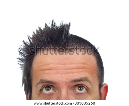 Man with funny haircut looking up to his half cut hair - isolated, copy space
