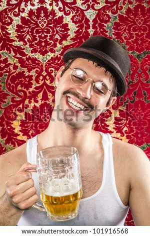 Man with funny smile, brown hat, white wife beater, spectacles, mustache getting drunk at vintage bar on light golden ale - stock photo