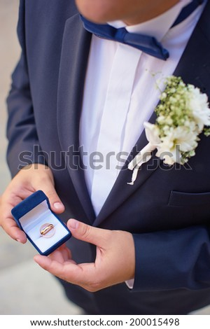 Man with gift box and wedding ring. - stock photo