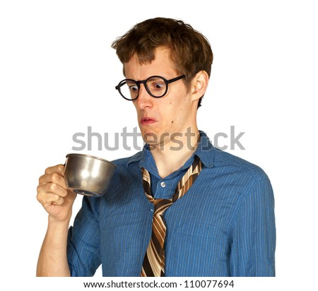 Man with glasses looking into metal cup, with look of distaste, isolated on white background.