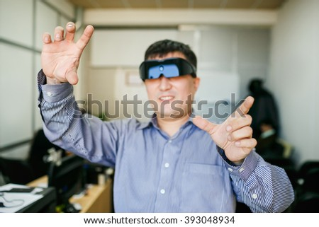 Man with glasses of virtual reality gesturing  - stock photo