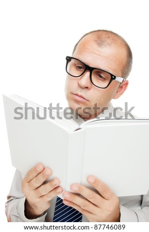 Man with glasses reading a book isolated on white - stock photo