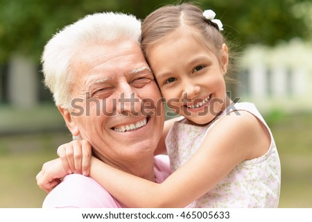 man with granddaughter in spring park