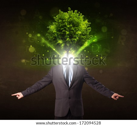 Man with green tree head concept on brown background - stock photo