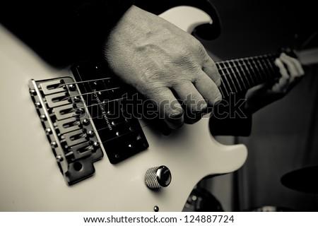 Man with guitar - stock photo