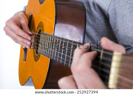 man with guitar on white background