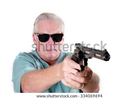 Man with gun.   a Man with a Gun or a Man with a Pistol or a Man with a .44 Magnum Revolver or a Man with a .44. Man with gun - stock photo