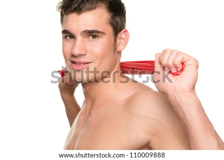 Man with gymnastic band in front of white background - stock photo