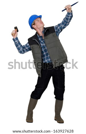 Man with hammer and chisel - stock photo