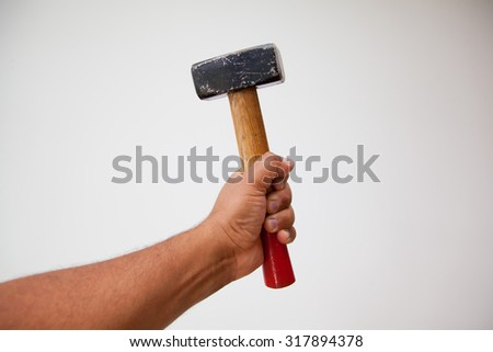 man with hammer in his hand