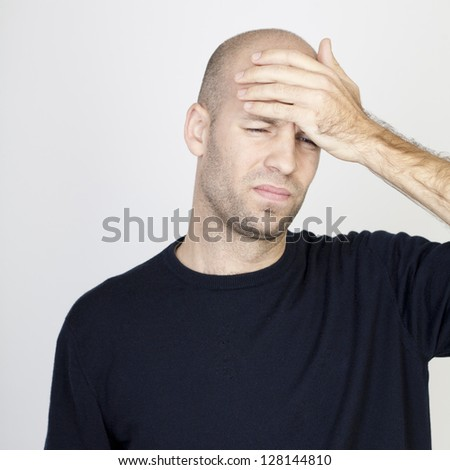 Man with hangover - stock photo