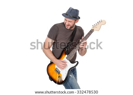 man with hat and beard play on electric guitar with enthusiasm. Isolated on white