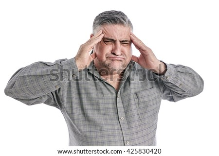 Man with head ache. People, health care and problem concept - unhappy man suffering. White background.