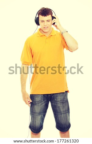 Man with headphones listenting to music  - stock photo