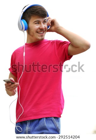 Man with headphones over blue sky background