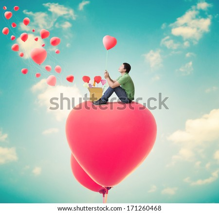 Man With Heart Balloons,Valentines Day Background - stock photo