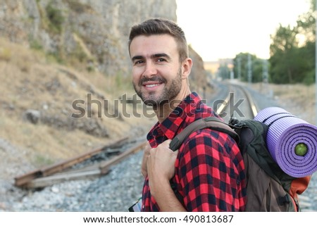 Man with hiking equipment about to start an adventure in the forest