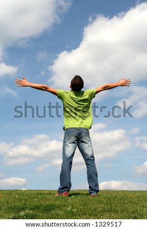 Man with his arms wide open - stock photo