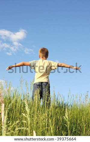 Man with his arms wide open his arms - freedom concept - stock photo