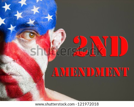 Man with his face painted with the flag of USA. Second Amendment expression concept. - stock photo