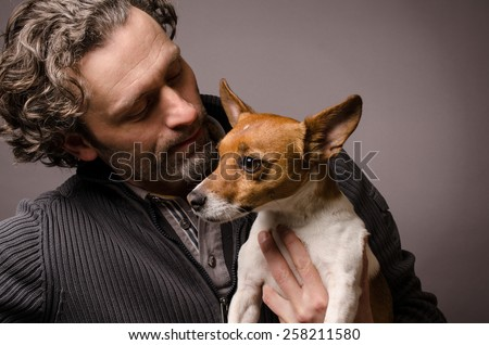 Man with his Jack Russell Terrier, studioshot - stock photo
