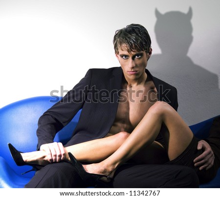 Man with horned shadow - stock photo