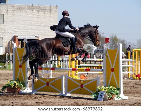 Man with horse show jumping - stock photo