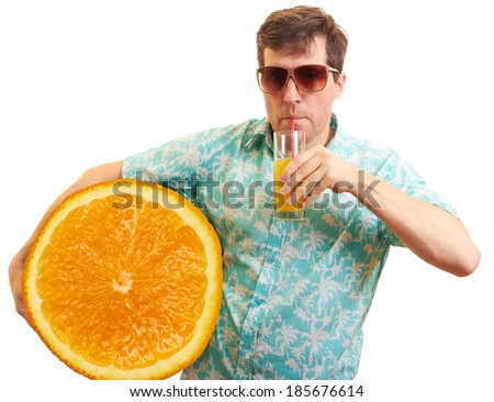 Man with huge orange fruit in the hands - stock photo