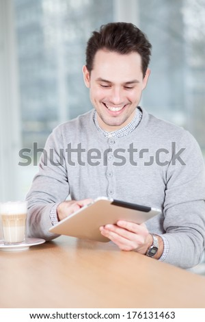 man with iPad