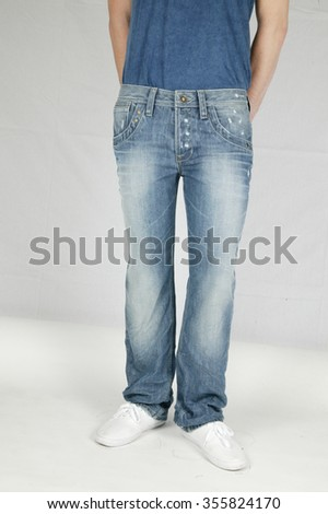 man with jeans and white shoes, white shoes, blue jeans