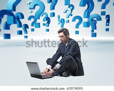 man with laptop and 3d question mark background - stock photo