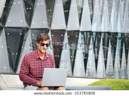 man with laptop outdoor - stock photo