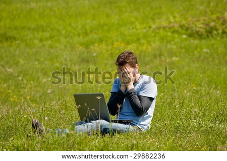 man with laptop outside working