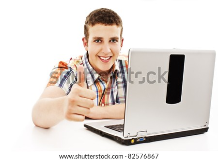 Man with laptop showing thumbs up. All on white background. - stock photo