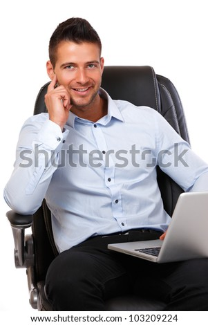man with laptop sitting in a leather chair - stock photo