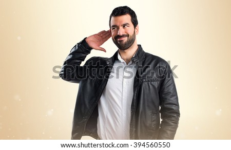 Man with leather jacket listening something