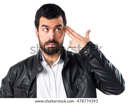 Man with leather jacket making suicide gesture