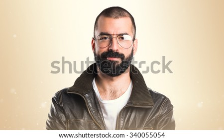 Man with leather jacket with his arms crossed
