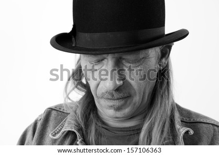 man with long hair and bowler hat