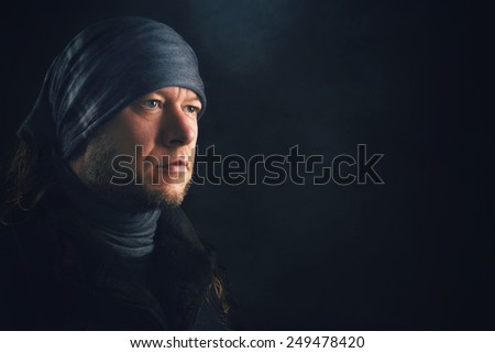 Man with long Hair,  Headwear and Scarf - stock photo