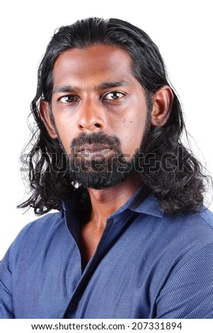 Man with long hair posing the camera with a serious look.