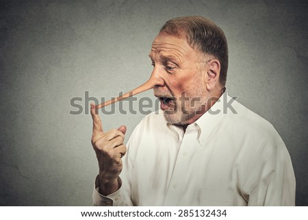Man with long nose shocked surprised isolated on grey wall background. Liar concept. Human face expressions, emotions, feelings. - stock photo
